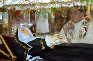 Auxiliary Bishop of Butuan, Most Reverend Zacarias Jimenez praying for an intercession to St. Rita of Cascia